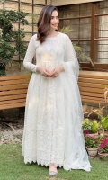 White chikan bodice laden anarkali paired with a beautiful lace net dupatta.