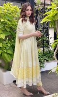 Soft primson yellow chikan angarkha paired with staright scalloped pants and chiffon dupatta.