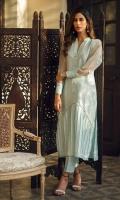 Ice blue raw silk sherwani with sheer organza puffy sleeves.