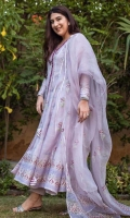 A Lavender organza net hand blocked Angarkha Kalidaar paired with structured straight raw silk pants and organza blocked dupatta.