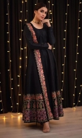 A crisp black raw silk kalidaar with kaleidoscopic block printed hues.