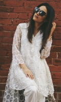 A chic, semi- formal, high-low style kameez. It is embellished with a geometric pattern and trendy embroidery.