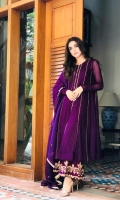 A brunt purple pishwas highlighting beautiful silhouette with gold buttons on the neckline. It's traditional cut is regal which comes with a delicate tilla work culottes and gold finishing dupatta.