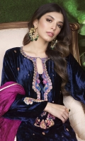 A deep sapphire toned velvet kurta, adorned with gold embroidery and silk thread-work in vibrant shades of magenta and fuchsia. A delicate floral motif dotted all over the front adds an extra bit of oomph to the ensemble. Further details are added to with an elegant back neckline and striking work on the sleeves. Style your look with khussas and statement earrings to make a stunning visual impact.  * Crush Silk Dupatta included.