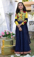 Yellow raw-silk jacket with floral embroidery and hand work  Navy Blue net lehnga with handwork Embellished with lace and trims and plain net duppatta