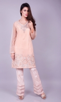 Always look pretty with this soft and beautiful net shirt in a soft peach with delicate embroidery on hem and neckline adorned with zardozi and crystals.