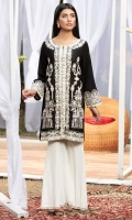 A classic black & white number with detailed thick white embroidery adorned with mock sheesha work.