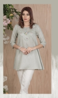 Dobby embroidered tunic with boat neck and 3 quarter sleeves.