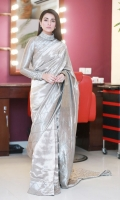 Be the queen of the night in 'Cleopatra's Vision', An astonishingly beautifully draped saree  with  a fully encrusted band collar which is heavily embellished with unconventional and conventional material that evolves around organza tied up with kora dabka work, in shades of grey and silver.  The princess panel blouse has pintex all over with vivacious criss cross embellishments of pearls and kora on the collar and cuffs. The borders of the saree has the same material used in frequency lines with patched pintex, along the hem of  pallu which has same fabric as that of the blouse.  A truly exquisite saree for the perfect regal look.  Fabric: 100% Pure tissue made to the highest standards of quality synonymous to Nilofer Shahid