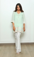 A mint shawl-fabric kurta containing bright embroideries and feminine finishes.