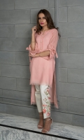 A classic baby pink shawl kurta with a high-low hemline, teamed with embroidered floral pants.