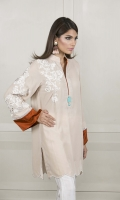 A beige velvet kurta containing white embroideries, rust contrast sleeve borders and pretty stones on the neckline.