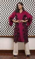 A vibrant pomegranate-pink marina kurta, appliqued with velvet patchwork.