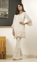 A white shawl-fabric kurta containing bright embroideries and feminine finishes.