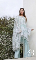 Soft aqua shirt front, back and sleeves embellished with sequin florets reminiscent of French lace paired with a slip and an Indian raw silk trouser, complimented with a lace designed resham embroidered net dupatta.