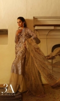 Period floral patterns carved out in copper sequin on front, back and sleeves on a delicate beige colored net provided with a slip and an Indian raw silk trouser paired with a beautiful bold floral embroidered net dupatta.