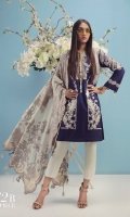 A navy blue and cream color-blocked printed lawn shirt with gold elements with a fusion of Uzbek embroidery and Chrysanthemum flowers. Floral embroidered bunches on organza are complemented by a cream Jacquard Dupatta.