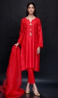This Indian raw silk red shirt with stitched organza triangles and handcrafted pearls and ribbons is paired with pants and organza dupatta to complete the look. *The length of the shirt is 42 inches.