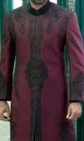 Maroon suiting fabric sherwani stitched in front open style and designed with flok print details on front back and sleeves and attached black velvet collar and sleeves finishing