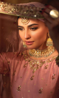 'Rukhsar' is a mauve hand embellished in gold and copper zardozi with rosey pink resham details, the classic pure raw silk pishwas still remains a popular choice for wedding wear. A heavily and exquisitely detailed embroidered bodice, flare, boarders and classy sleeves are paired with organza mauve dupatta and it has intricate hand embroidered borders along with Chan booti and raw silk green paltawa paired with pure raw silk mauve churidar. A customized pouch can be added to the outfit upon request.