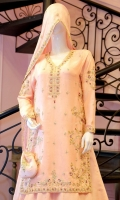 It is a mingling of elegance and tradition. A pure raw silk outfit in blush pink with hints of mauve resham work. The dress is intricately embellished with gold and silver zardoze work with pearls on a floral theme and is paired with handcrafted matching  pure raw silk lehanga with intricate hand embellishments. It is adorned and finished with banarsi in hues of pink and gota lace, worn with a flowing embroidered blush pink dupatta in medium silk with a hand embellished border and booti. A matching pouch can be made on order to complete the look.