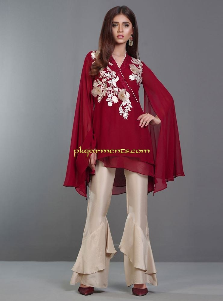 769fbc959a Look alluring in our deep maroon chiffon uber chic asymmetric top with  subtle floral embroidery.