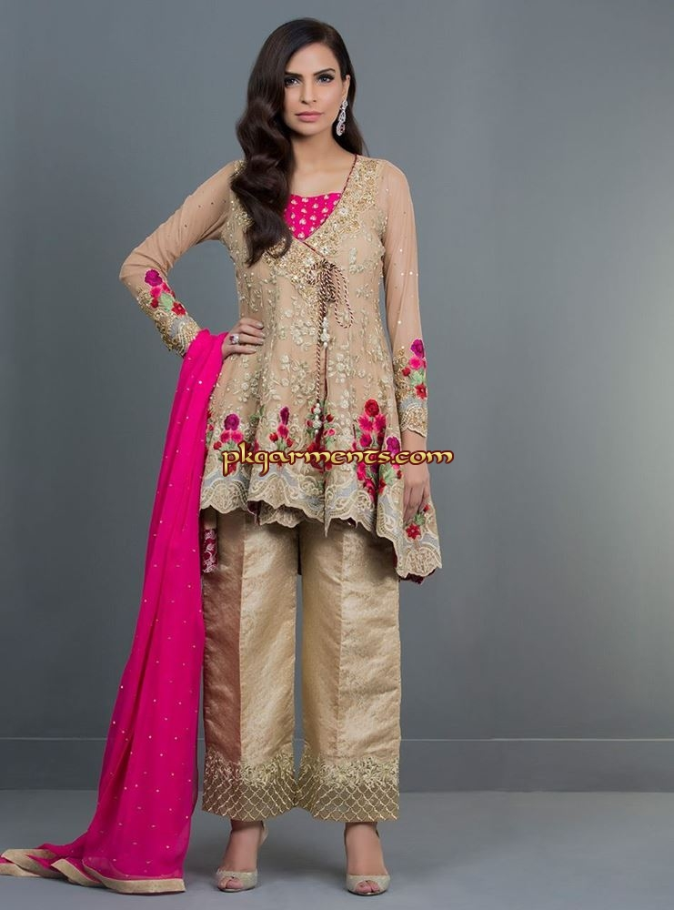 9e61b76a2e This beautiful ensemble: a combination of beige with vibrant floral  embroidery on the daaman strikes