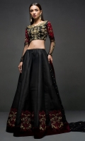 Adorned in a black choli sharara embellished with antique gold detailing on the neckline with contrasting embroidery in shades of red on sleeves and sharara, this attire will elevate your style. It comes with black net embellished dupatta.