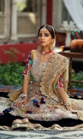 Heavily worked gold choli with colorful sleeves. It is paired with a worked lehnga with border detailing and a heavily worked scalloped dupatta.