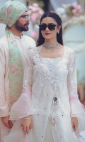 A white angrakha made of exclusively woven chiffon jacquard for Zainab Salman. It is embellished with mirrors, lace finishing and scalloped edges. The look is completed with signature ZS mirror tassels. Lawn slip included.