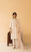 Crisp white loose fit kurta with embroidery all over, paired with straight fit pants and peach dupatta Style the look with oversized hoops