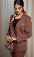 Our refined two-piece rust power suit with collarless finely modified V neckline. Ease fit blazer with ring buckle details at center front. Delicately tailored cropped pants with tapered hem and two front pockets.