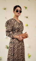 Animal printed chiffon midi dress with A-line silhouette and side-slit skirt with straight hem. Over lapping V-neckline connecting with front skirt's slit and detailed pleated sleeves from the top.