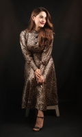 A classic animal print silk dress that flows elegantly with front placket and smart cuffs embellished with fabric buttons.