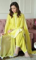 Saffron yellow block printed cotton net kurta and shalwar paired with a chiffon dupatta.