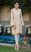 Beige raw silk kurta highlighted with pleats, long pearl lines, and fan tassels. Paired with worked self on self cigarette pants.
