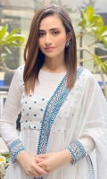 Sana Javed looking absolutely gorgeous in this white pishwas. It is meticulously hand-embroidered paired with white churidar and dupatta to complete the look.