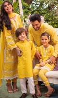Pineapple yellow schiffli kurta with white embellishments paired with pants.