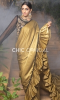 This statement sari is a mix of sequins and velvet silk fabric. Sequins Fabric Blouse is adorned with traditional floral motif of Zardozi  Kora Dabka Kutdana pearls and Crystals. Velvet silk is used in Pallu Featuring layers of pleated Frills...