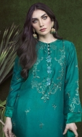 A classic mono-tone emerald green statement outfit that is all the rage in current trends! A fully embroidered raw silk Kurta with a delicate trellis on the daaman, a modern neckline and floral booties on the back and front that are enhanced by intricate hand embellished motives in French knot embroidery in the front neckline. The forever flattering above-the-knee cut aided by short slits makes this an easy go-to dress for every occasion! The beautifully trimmed silk dupatta uplifts your day or night look!
