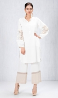 White grip silk shirt with lace adorned sleeves and pearl button detailing accompanied by white and beige colour block pants in grip silk