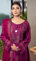 The loose long traditional kurta incorporates block-printed motifs, dori along side the panels, embroidery on the neckline, along with sheesh buttons to add a hint of glimmer. The kurta is finished with self embroidered cuts and magenta tassels, including the sleeves, it is accompanied by a matching organza dupatta finished with a block print border and straight pants for a perfect eid look this season.