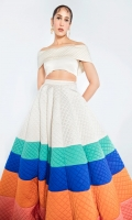 A summer spectacle skirt flowing with colorful waves on a white canvas paired with a white blouse.