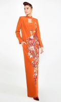An oranged toned gown beautified by a floral splattering of pink, white and green.