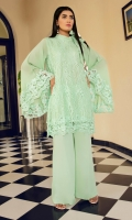 Acid green embroidered net shirt with a 2 layer effect, exaggerated sleeves with border and a band collar with bow tie. It comes with loose fit trousers.