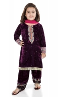 3 piece Shirt, shalwar and dupatta Purple velvet shirt with embroidered patti on sleeves and neck Sequin spray on shirt Purple velvet embroidered shalwar with pink net dupatta Embellished with tilla balls, buttons and kiran lace