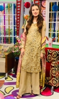 A flattering straight Mukesh ensemble with luxe beaded fringe is delicately embellished with crystal and thread work in ornate patterns on a sublime shade of gold. Accompanied with flared pants that are adorned with Swarovski to create a luxuriously chic look.  Fabric: 100% Pure Mukesh made to the highest standards of quality synonymous to Nilofer Shahid.