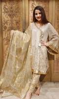 Rendered in ash white hues, 'Ash Symphony' is a scintillating angrakha with a flattering neckline painstakingly adorned with gold ornamentation and seed pearls. Delicate gold threadwork is trailing towards the hem, with gorgeous heavy gold tassels to create classic designs that pay homage to our heritage.  Fabric: 100% Pure Embroidered Organza Karandi made to the highest standards of quality synonymous to Nilofer Shahid.