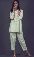 Loose fitting shirt with contrast embroidery detail on front and buttons on neck plaket.