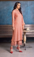 Less is more with this perfectly minimal look- a sleek tailored embroidered kurta in a pretty coral colour, paired with raw silk pants.
